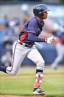 Rome Braves center fielder Cristian Pache (25) runs to first base during a game against the Asheville Tourists at McCormick Field on May 22, 2017 in Asheville, North Carolina. The Braves defeated the Tourists 7-3. (Tony Farlow/Four Seam Images)