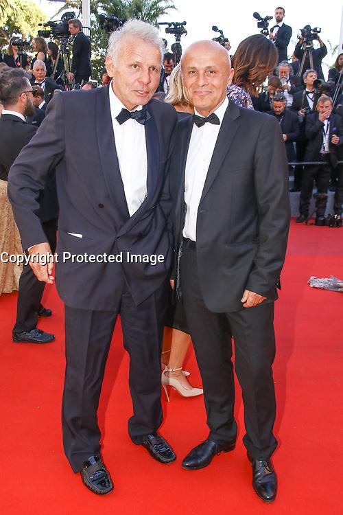 Patrick Poivre d'Arvor et son frere Olivier Poivre d'Arvor sur le tapis rouge pour la projection du film en competition OKJA lors du soixante-dixiËme (70Ëme) Festival du Film ‡ Cannes, Palais des Festivals et des Congres, Cannes, Sud de la France, vendredi 19 mai 2017.