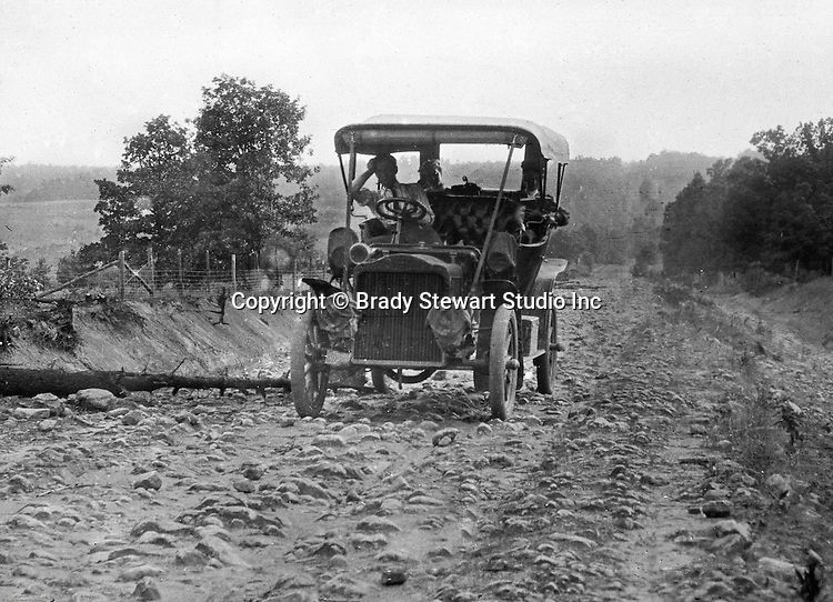 Greensburg PA:  The 1906 Buick Model F broken down after running over a tree on a rocky road outside Greensburg PA.