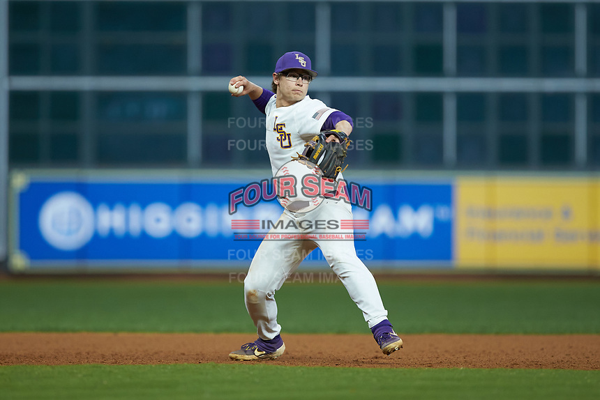 LSU Tigers third baseman Zack Mathis (17) makes a throw to first base against the Texas Longhorns in game three of the 2020 Shriners Hospitals for Children College Classic at Minute Maid Park on February 28, 2020 in Houston, Texas. The Tigers defeated the Longhorns 4-3. (Brian Westerholt/Four Seam Images)