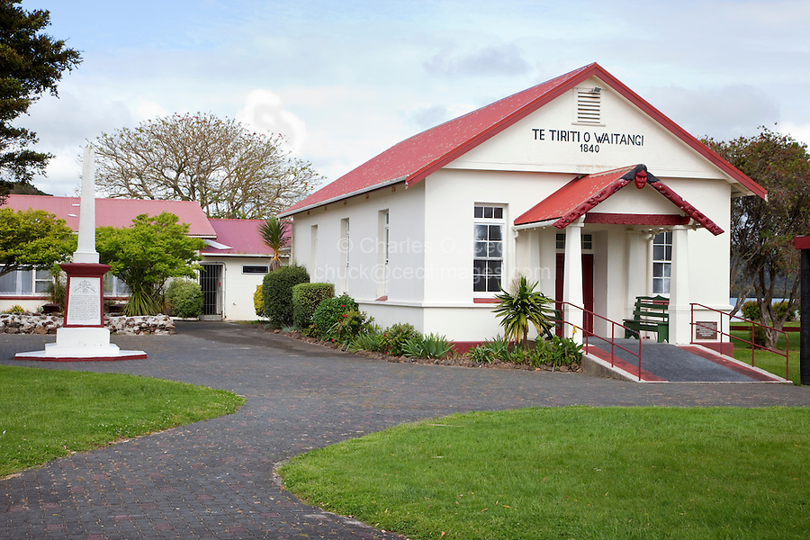 Maori Meeting House, Te Tiriti o Waitangi, erected 1964, Paihia, north island, New Zealand.  The monument on the left commemorates the signing of the Treaty of Waitangi in 1840.