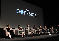 """NEW YORK CITY - OCTOBER 5: (L-R) Rosario Dawson, Kaitlin Dever, John Hoogenakker, Will Poulter, Peter Sarsgaard, Michel Keaton, and moderator Joe Neumaier attend a SAG Screening of Hulu's """"DOPESICK"""" at the Museum of Modern Art on October 5, 2021 in New York City. . (Photo by Frank Micelotta/Hulu/PictureGroup)"""
