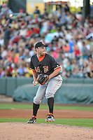 Jordan Jankowski (44) of the Fresno Grizzlies delivers a pitch to the plate against the Salt Lake Bees in Pacific Coast League action at Smith's Ballpark on June 13, 2015 in Salt Lake City, Utah.  (Stephen Smith/Four Seam Images)