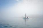 Fishing boat in morning fog, Stephens Passage, Southeast Alaska, USA
