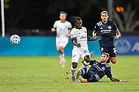 LAKE BUENA VISTA, FL - AUGUST 01: Valentín Castellanos #11 of New York City FC slides to kick the ball away from Yimmi Chará #23 of the Portland Timbers during a game between Portland Timbers and New York City FC at ESPN Wide World of Sports on August 01, 2020 in Lake Buena Vista, Florida.
