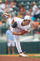Texas Longhorns pitcher Dillon Peters #32 follows through on his pitch to the plate during the NCAA baseball game against the Oklahoma State Cowboys on April 26, 2014 at UFCU Disch–Falk Field in Austin, Texas. The Cowboys defeated the Longhorns 2-1. (Andrew Woolley/Four Seam Images)