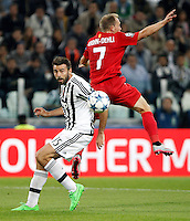 Calcio, Champions League: Gruppo D - Juventus vs Siviglia. Torino, Juventus Stadium, 30 settembre 2015. <br /> Juventus' Andrea Barzagli, left, and Sevilla's Michael Krohn-Dehli fight for the ball during the Group D Champions League football match between Juventus and Sevilla at Turin's Juventus Stadium, 30 September 2015. <br /> UPDATE IMAGES PRESS/Isabella Bonotto