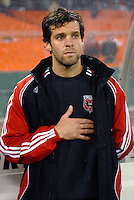 DC United midfielder Ben Olsen (14) during the singing of the National Anthem. DC United defeated CD Olimpia 3-2 to advance to the semi finals of the CONCACAF Champions' Cup. March 1, 2007 at RFK Stadium in Washington DC.