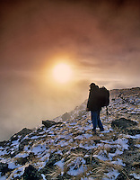 Backpacker at top of Kieger Gorge with snow and ice. Steens Mountain, Oregon.
