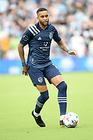 KANSAS CITY, KS - JUNE 26: Amadou Dia #13 Sporting KC with the ball during a game between Los Angeles FC and Sporting Kansas City at Children's Mercy Park on June 26, 2021 in Kansas City, Kansas.