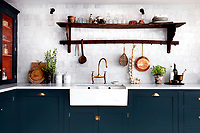 DeVol's 'Real Shaker Kitchen' cabinets and larder cupboard are painted in 'Studio Green' by Farrow & Ball