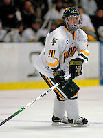 "5 January 2007: University of Vermont forward Reese Wisnowski (20) from East Middlebury, VT, in action against the University of New Hampshire Wildcats at Gutterson Fieldhouse in Burlington, Vermont. The UNH Wildcats defeated the UVM Catamounts 7-1 in front of a record setting 48th consecutive sellout at ""the Gut""...Mandatory Photo Credit: Ed Wolfstein Photo.<br />"