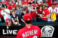 Head Coach Mike Matheny (22) of the St. Louis Cardinals signs autographs for fans prior to a game against the Springfield Cardinals at Hammons Field on April 2, 2012 in Springfield, Missouri. (David Welker/Four Seam Images)