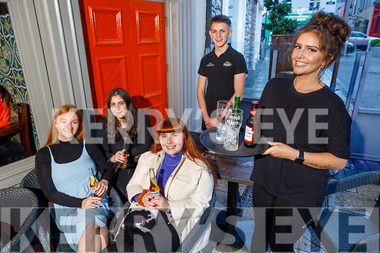 Enjoying the evening in the Fiddler Bar in Tralee on Tuesday.<br /> Front right: Erica Tynan.<br /> Seated l to r: Kasey O'Connor, Ailbhe Hussey, Ciara Mahoney and Brian Cassidy