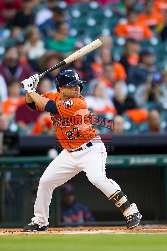 Houston Astros second baseman Jose Altuve (27) at bat during the MLB baseball game against the Detroit Tigers on May 3, 2013 at Minute Maid Park in Houston, Texas. Detroit defeated Houston 4-3. (Andrew Woolley/Four Seam Images).