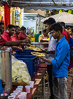 Serving Food at Hindu Navarathri Celebrations, Sri Maha Mariamman Temple, George Town, Penang, Malaysia.