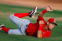 Erick Salcedo #19 of the AZL Angels stretches before a game against the AZL Diamondbacks at Tempe Diablo Stadium on July 14, 2013 in Tempe, Arizona. AZL Angels defeated the AZL Diamondbacks, 5-3. (Larry Goren/Four Seam Images)