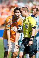 Houston Dynamo defender Geoff Cameron (20) argues with referee Mark Geiger over a penalty kick call.  Houston Dynamo defeated Colorado Rapids 1-0 at Robertson Stadium in Houston, TX on April 19, 2009.