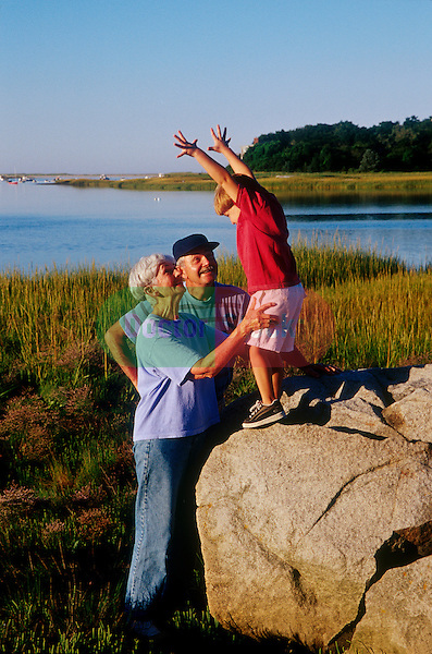 grandparents playing with grandson in marsh