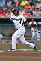Tennessee Smokies shortstop Addison Russell #4 swings at a pitch during a game against the Jacksonville Suns at Smokies Park July 10, 2014 in Kodak, Tennessee. The Suns defeated the Smokies 6-5. (Tony Farlow/Four Seam Images)