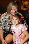 Kathy Minter and her daughter Reagan at the University of Texas M.D. Anderson Cancer Center and The Galleria's Back to School Fashion Show benefitting pediatric cancer patients at The Galleria Saturday August 25,2012.(Dave Rossman Photo)