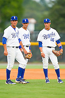 (L-R) Burlington Royals infielders Patrick Leonard (30), Kenneth Diekroeger (32) and Mark Threlkeld (26) wait for the relief pitcher to finish his warm up tosses during the game against the Danville Braves at Burlington Athletic Park on July 18, 2012 in Burlington, North Carolina.  The Royals defeated the Braves 4-3 in 11 innings.  (Brian Westerholt/Four Seam Images)