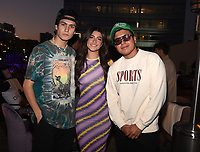 """LOS ANGELES - SEPT 2: Chase Hudson, Charli D'Amelio, and Bryant Eslava attend a screening of Hulu's """"The D'Amelio Show"""" at NeueHouse Rooftop Hollywood on September 2, 2021 in Los Angeles, California. (Photo by Frank Micelotta/Hulu/PictureGroup)"""