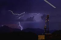 Aug. 21, 2012; Phoenix, AZ, USA: lightning bolt storm monsoon cloud thunderstorm airplane night antenna South Mountain Mandatory Credit: Mark J. Rebilas