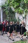 Beating the Bounds takes place annually on Ascension Day at All Hallows by the Tower, London. Children from St Dunstans College, Catford, return to their roots in the parish of St Dunstan-in-the-East to take an active part in the proceedings. Seen here in the 'secret garden' of the ruined church they are walking the parish boundaries.