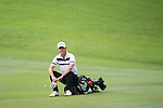 Jason Scrivener of Australia sits on his bag during Hong Kong Open golf tournament at the Fanling golf course on 25 October 2015 in Hong Kong, China. Photo by Aitor Alcade / Power Sport Images