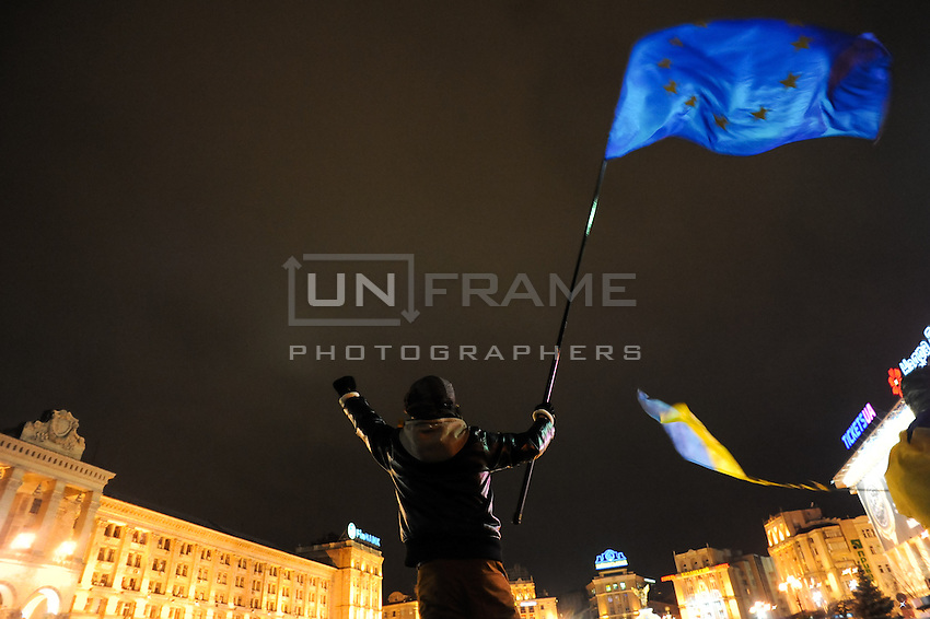 EU flag in hands of young protester.  People gather in the independece square in Kiev. Ukriane in the night of EU samit in Vilnus. Thousands of people are continuing to express their support to european integration and protesting against decision of Ukrainian government to refuse signing of association with EU in Vilnius.
