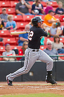 Michael Marjama (12) of the Kannapolis Intimidators follows through on his swing against the Hickory Crawdads at L.P. Frans Stadium on May 25, 2013 in Hickory, North Carolina.  The Crawdads defeated the Intimidators 14-3.  (Brian Westerholt/Four Seam Images)