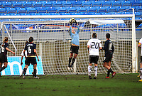 USA goalkeeper Hope Solo stretches high to make a save against Germany.  The USA captured the 2010 Algarve Cup title by defeating Germany 3-2, at Estadio Algarve on March 3, 2010.