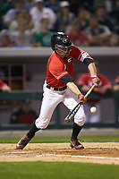 Stephen Wrenn (11) of the Georgia Bulldogs lays down a bunt against the Charlotte 49ers at BB&T Ballpark on March 8, 2016 in Charlotte, North Carolina. The 49ers defeated the Bulldogs 15-4. (Brian Westerholt/Four Seam Images)