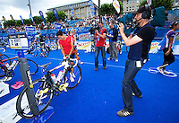 17 JUL 2011 - HAMBURG, GER - Andrea Hewitt (NZL) under the scrutiny of television cameras prepares in transition for the start of the women's Hamburg round of triathlon's ITU World Championship Series  (PHOTO (C) NIGEL FARROW)