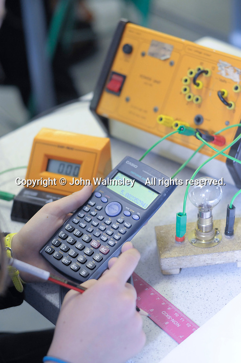 Using a calculator for an experiment with electrical circuits, state secondary school.