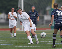 Boston Aztec midfielder Marina Moschitto (24) passes the ball.  In a Women's Premier Soccer League (WPSL) match, Boston Aztec (white) defeated Seacoast United Phantoms (blue), 3-0, at North Reading High School Stadium on Arthur J. Kenney Athletic Field on on June 25, 2013.