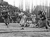 Marty Martinello and Angelo Mosca HamiltonTiger Cats chase down Ottawa Rough Rider quarterback Russ Jackson 1965. Copyright photograph Ted Grant