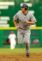 13 June 2006: Garrett Atkins, third baseman for the Colorado Rockies, hustles to third base during a game against the Washington Nationals at RFK Stadium, in Washington, DC. The Rockies defeated the Nationals 9-2 in the second game of the four-game series...Mandatory Photo Credit: Ed Wolfstein Photo..