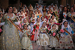 Young girls in traditional dress in the procession of Flowers offering to the Virgin Desamparados during Fallas Festival. Valencia. Spain
