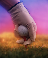 Digital enhancement of a golf ball in a gloved hand.