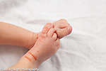 3 day old newborn baby boy closeup of peeling, cracked feet