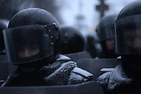 A deployment of riot poice face the barricades under the snow during the protest against new draconian law to ban protests across the country.  Kiev. Ukraine