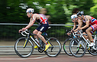 31 MAY 2014 - LONDON, GBR - Jonathan Brownlee (GBR) (ENG) (left) of Great Britain races around Hyde Park during the 2014 ITU World Triathlon Series round in London, Great Britain (PHOTO COPYRIGHT © 2014 NIGEL FARROW, ALL RIGHTS RESERVED)