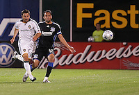Dema Kovalenko (8) and Ramiro Corrales (12) follow the ball. San Jose Earthquakes tied Los Angeles Galaxy 1-1 at the McAfee Colisum in Oakland, California on April 18, 2009.