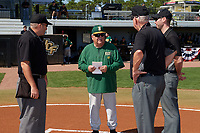 Siena Saints head coach Tony Rossi (40) during the lineup exchange with umpires John Bennett, Jason Werle, and Rick Darby before a game against the UCF Knights on February 17, 2019 at John Euliano Park in Orlando, Florida.  UCF defeated Siena 7-1.  (Mike Janes/Four Seam Images)
