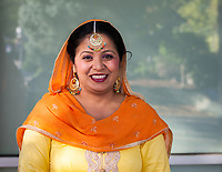 Indian Woman Wearing Orange & Yellow Traditional Clothing, Renton Multicultural Festival 2017, WA, USA.