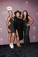 Chapel Hart - Danica Hart, Devynn Hart, Trea Swindle attend the 2021 CMT Artist of the Year on October 13, 2021 in Nashville, Tennessee. Photo: Ed Rode/imageSPACE/MediaPunch
