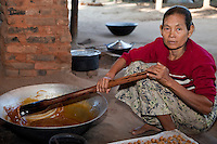 Myanmar, Burma, near Bagan.  Heating Toddy Palm Juice to Make Sugar.