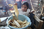 A Native nahuatl giirl prepares tamales on a comal in her village of Acaxochitlan village, in northern state of Hidalgo, during the festivities of the Day of the Deads. Hundreds of Native villages pay homage to their deads on the eve of November 2 as a tradition since the preHispanic times. Photo by Heriberto Rodriguez